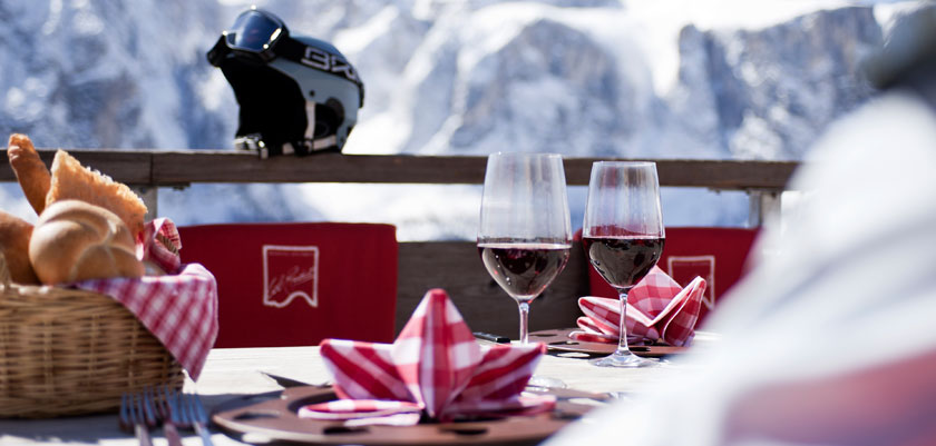 Italy_The-Dolomites-Ski-Area_Wine-table-setting-mountains.jpg